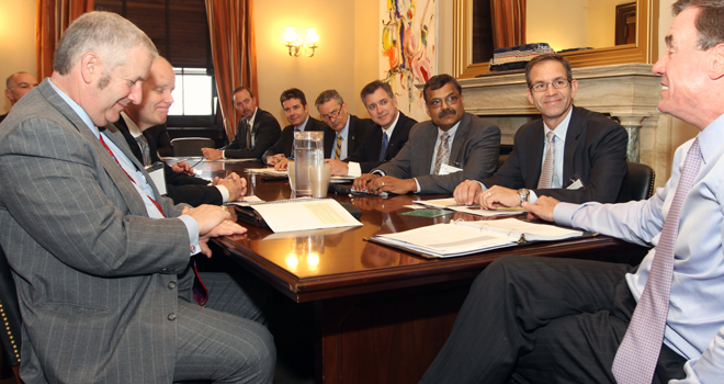 Bhawnesh joins IPC Government Relations Committee colleagues and IPC President and CEO John Mitchell in a light-hearted moment with Senator Mark Warner